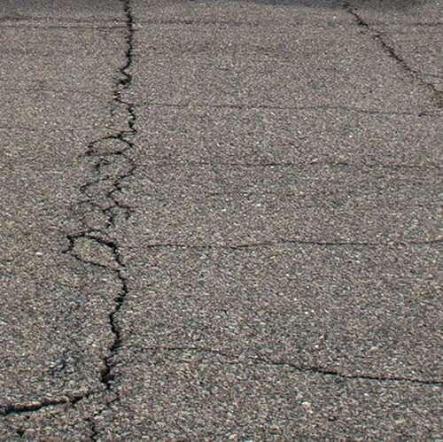 Cracked asphalt parking lot