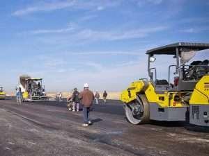 Asphalt Paving Company laying asphalt on road